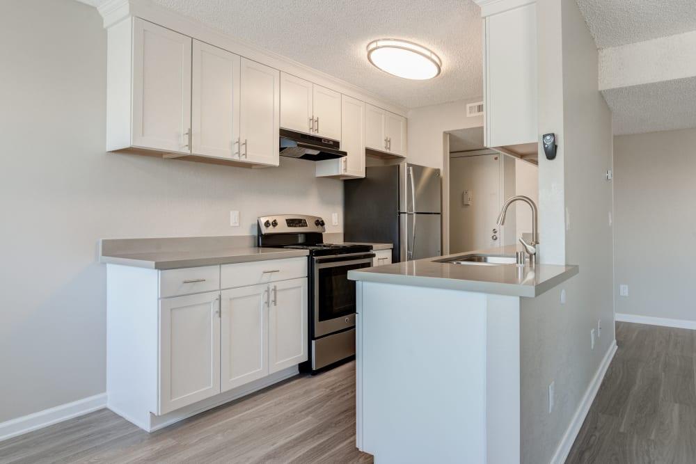 Modern kitchen with stainless-steel appliances in a model home at Veranda La Mesa in La Mesa, California
