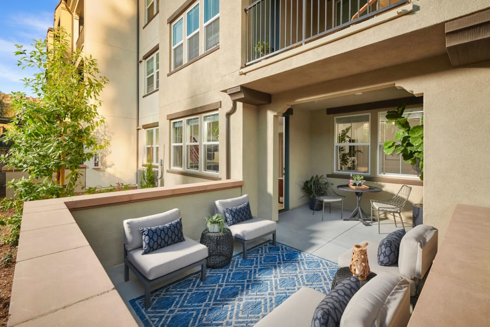 Outdoor seating on balcony at The Trails at Canyon Crest in Riverside, California