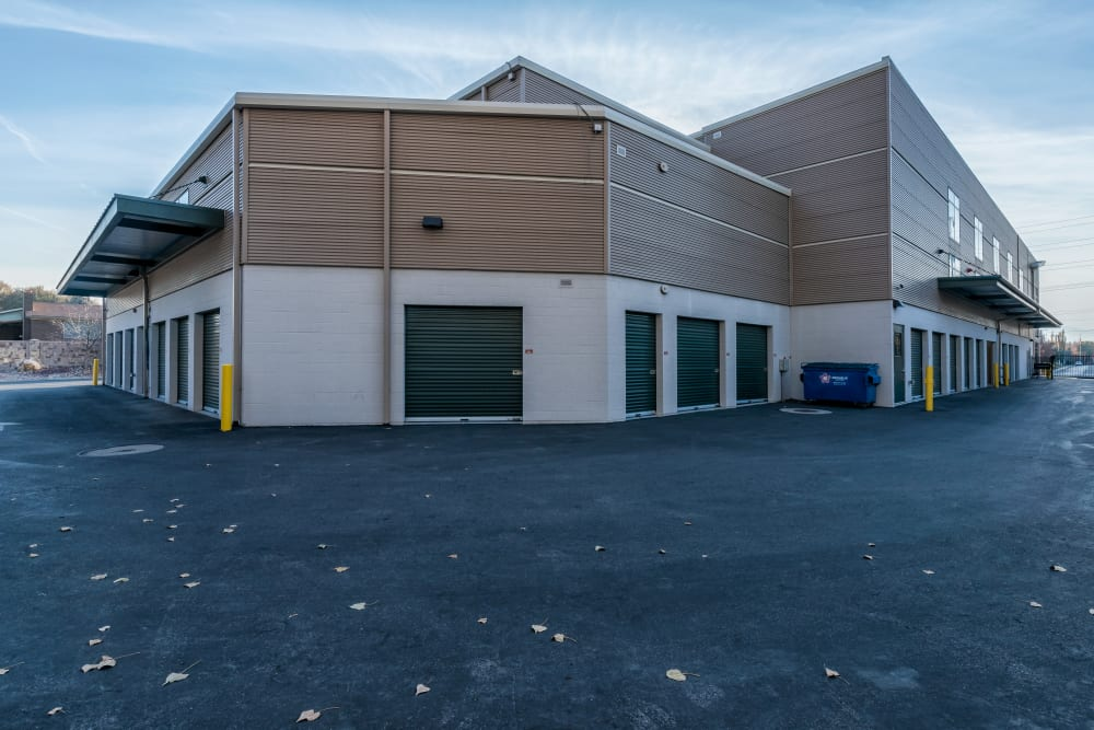 A large, open driveway with drive-up storage units at Cubes Self Storage in Cottonwood Heights, Utah