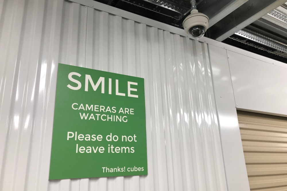 Security camera and sign at Cubes Self Storage in Farmington, Utah