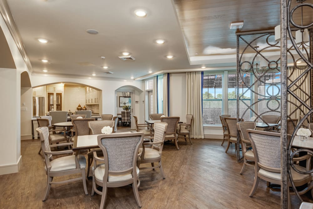 Resident dining room with hardwood floors at Anthology of Louisville in Louisville, Kentucky