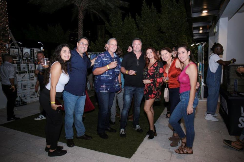 Group photo at event at Yard 8 Midtown in Miami, Florida