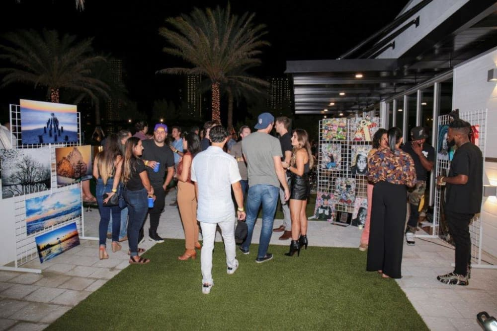 Residents enjoying the event at Yard 8 Midtown in Miami, Florida