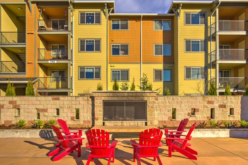 Large outdoor fireplace with seating at Vue Issaquah in Issaquah, Washington