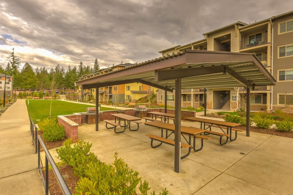 Covered outdoor seating with grilling stations at Vue Issaquah in Issaquah, Washington