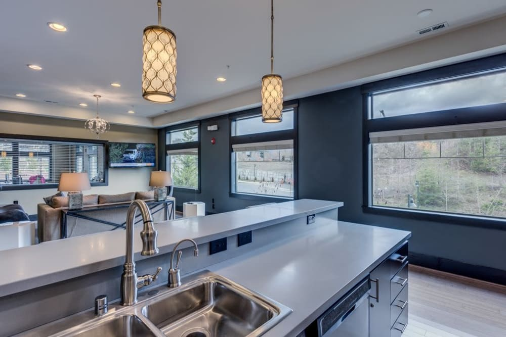 Clubhouse kitchen for entertaining guests at Vue Issaquah in Issaquah, Washington