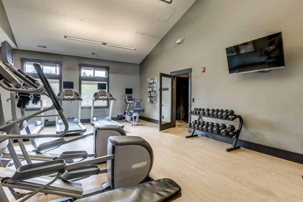 Gym with individual workout stations at Vue Issaquah in Issaquah, Washington