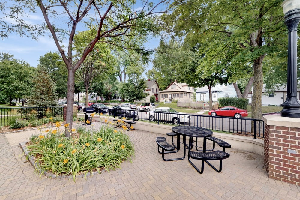 Outdoor patio seating at Oaks Hiawatha Station in Minneapolis, Minnesota