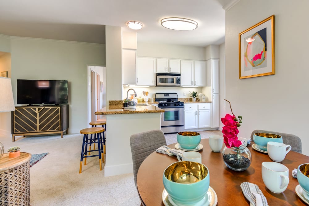 Spacious open floor plan with the kitchen overlooking the dining room at Sofi Shadowridge in Vista, California