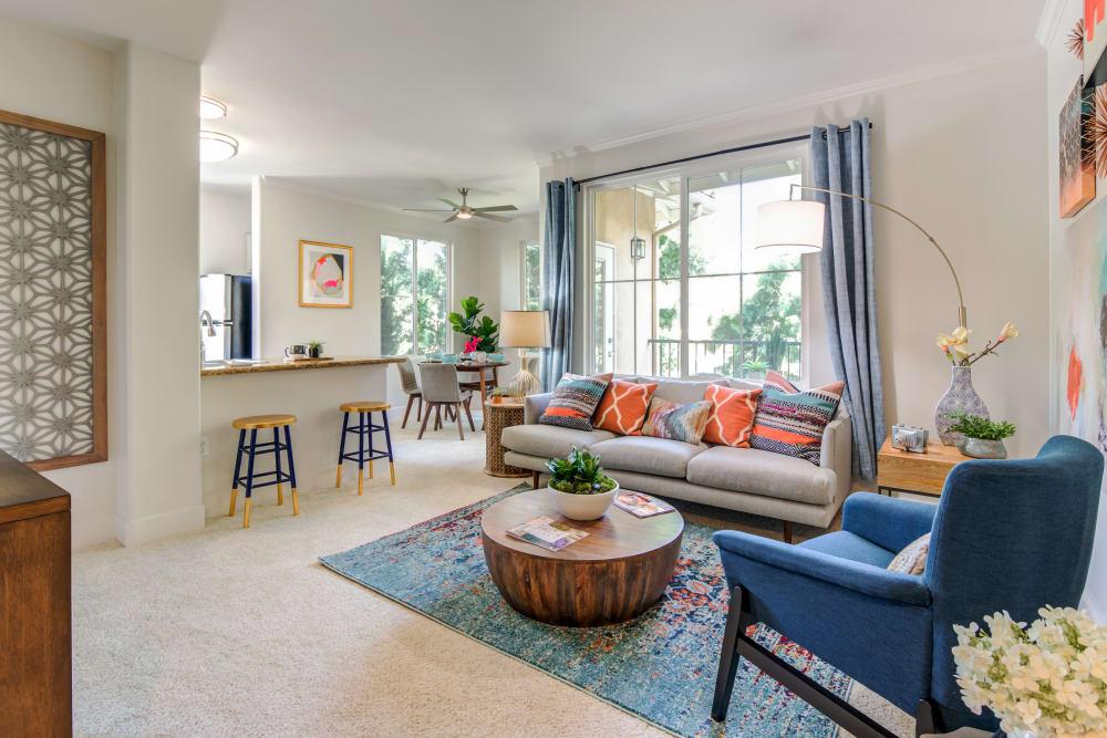 Spacious living room with back patio access at Sofi Shadowridge in Vista, California