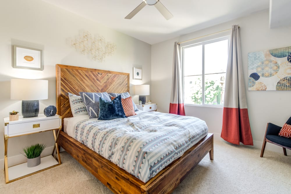 Large bedroom with a ceiling fan at Sofi Shadowridge in Vista, California