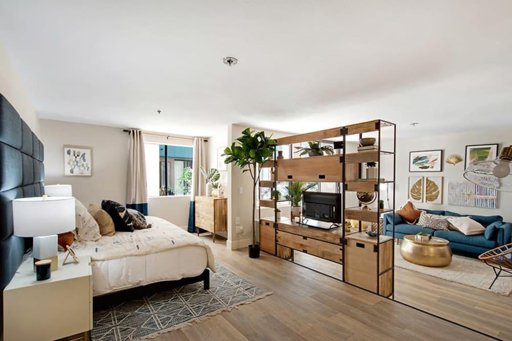 Studio floor plan with hardwood floors and modern decor in a model home at Vue Los Feliz in Los Angeles, California