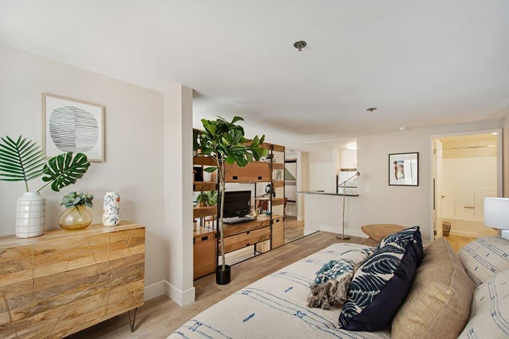 Comfortable bedroom area of a model home's studio layout at Vue Los Feliz in Los Angeles, California