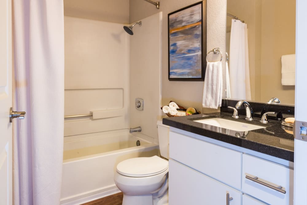 Bathroom with an oval tub at Haven Martinez in Martinez, California