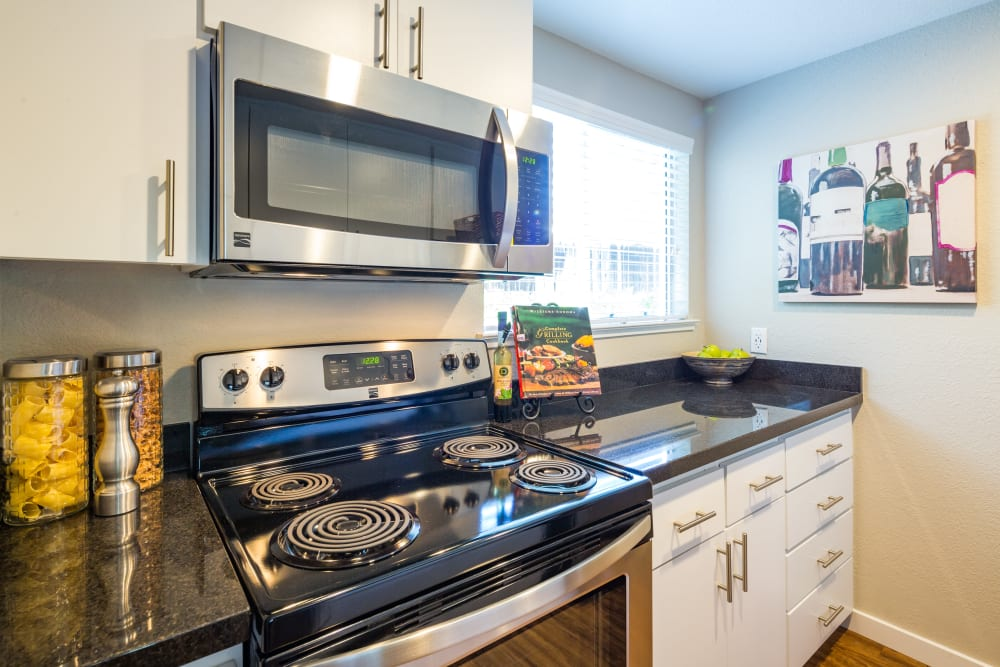 Kitchen with stainless-steel appliances at Haven Martinez in Martinez, California