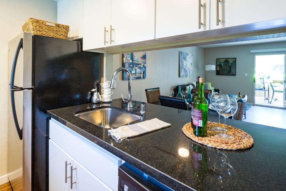 Kitchen with a pass-through window at Haven Martinez in Martinez, California