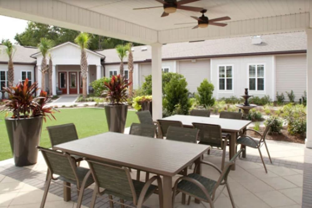 Covered outdoor seating at Ortega Gardens Alzheimer's Special Care Center in Jacksonville, Florida