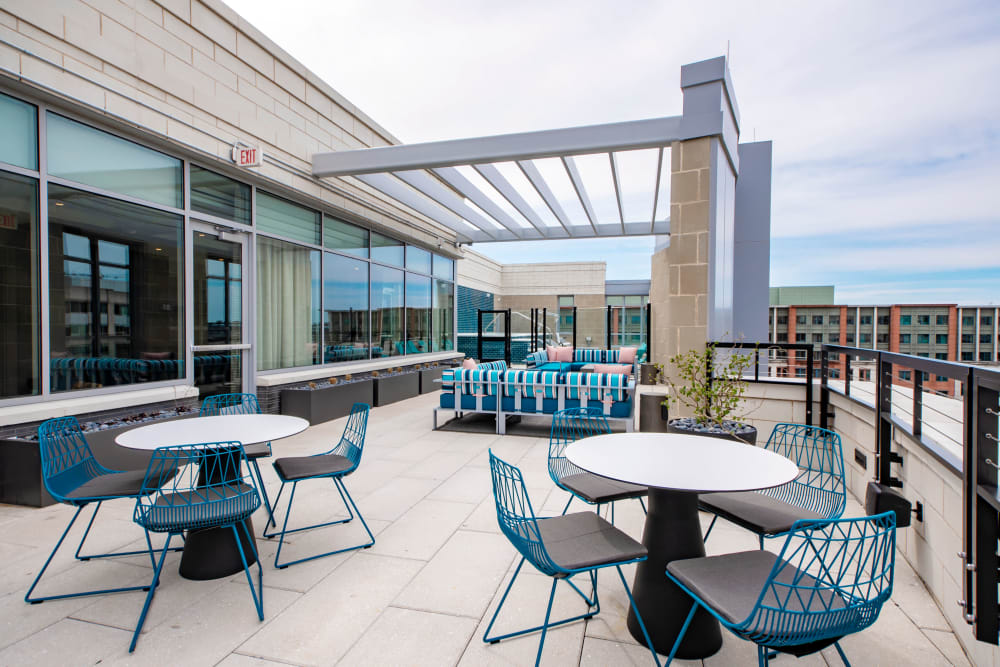 Roof-top deck with plenty of tables and chairs for entertaining guests at Harlow in Washington, District of Columbia