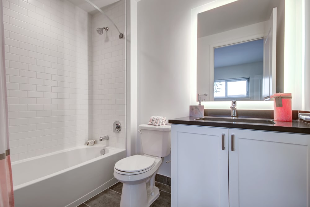 Bathroom with an oval tub at Harlow in Washington, District of Columbia