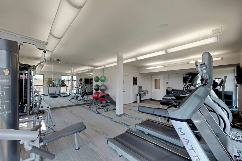 Fully equipped fitness center at Oaks Trinity in Dallas, Texas