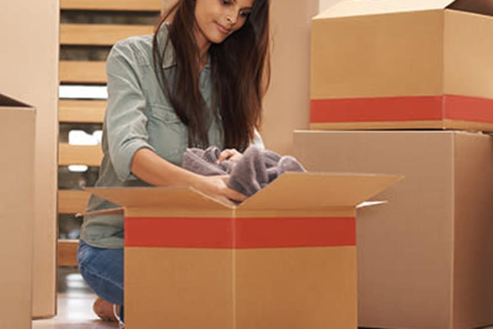 Unpacking boxes at Monster Self Storage in Orangeburg, South Carolina