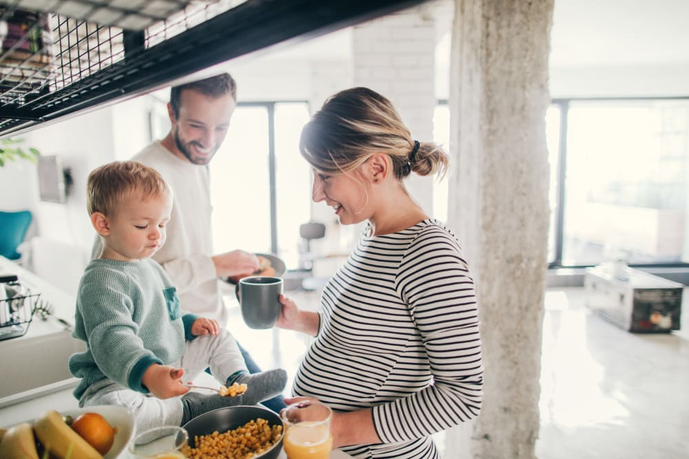 Family cooking together at Oaks Glen Lake in Minnetonka, Minnesota