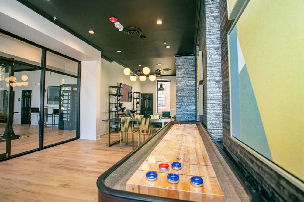 Shuffleboard and game room at Lofts at Riverwalk