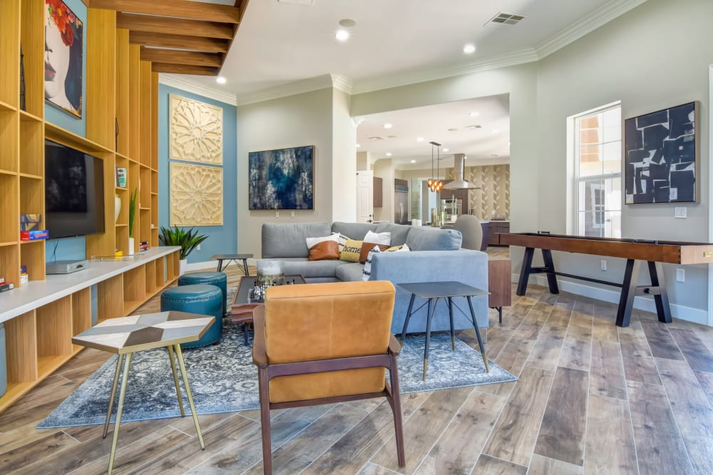 Community game room with a large TV and plenty of seating at Sofi Shadowridge in Vista, California