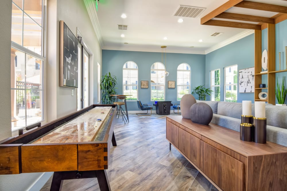 Game room in the clubhouse with shuffle board at Sofi Shadowridge in Vista, California