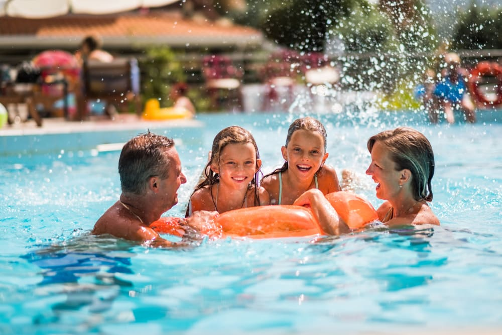 Family swimming together at Oaks Lincoln Apartments & Townhomes in Edina, Minnesota