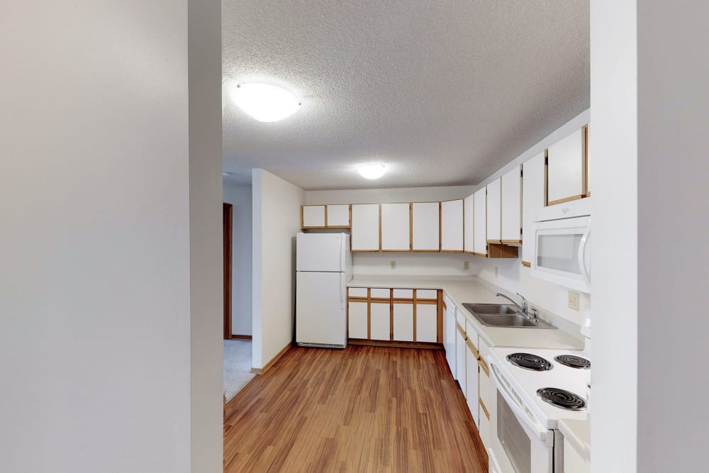 Fully equipped kitchen at Oaks Lincoln Apartments & Townhomes in Edina, Minnesota