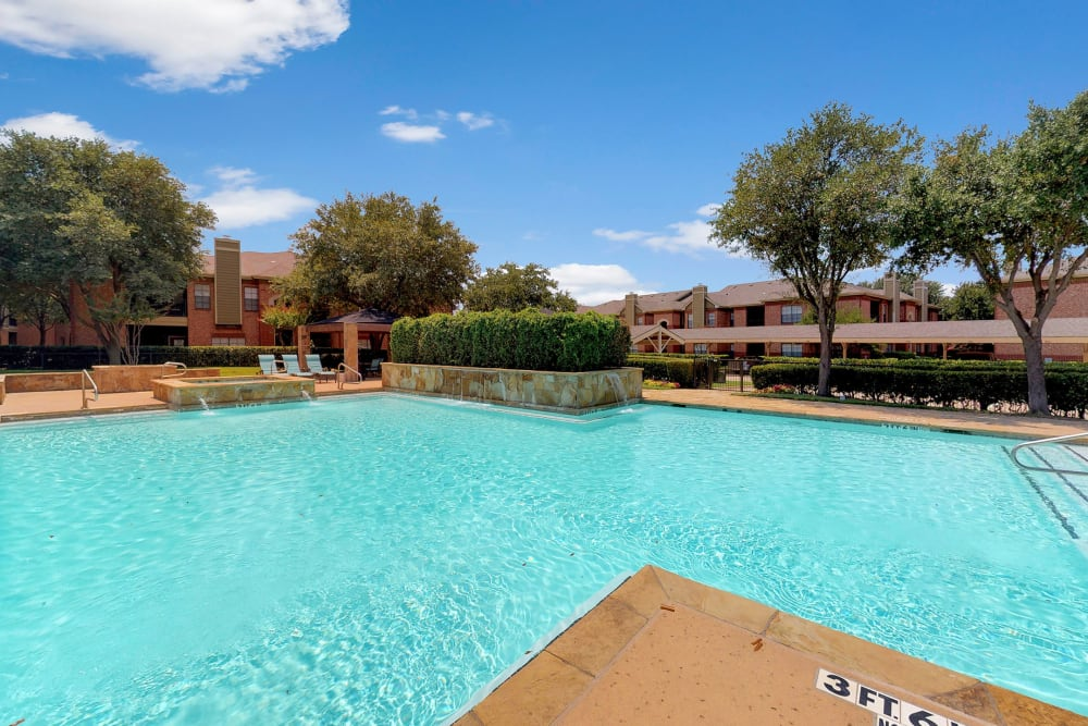 Sparkling resort-style swimming pool at Oaks Riverchase in Coppell, Texas