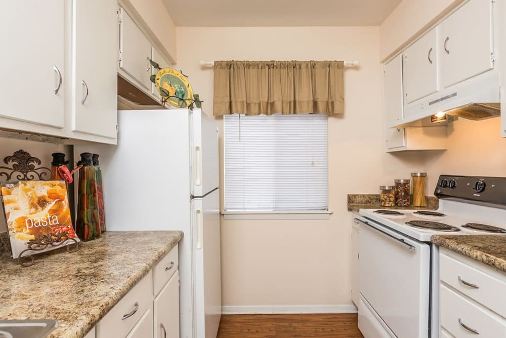 An apartment kitchen with a window at Reserve at Altama in Brunswick, Georgia