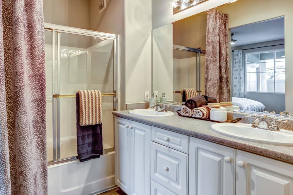 Plenty of under-counter drawer and cabinet storage in a model home's master bathroom at Sofi Highlands in San Diego, California