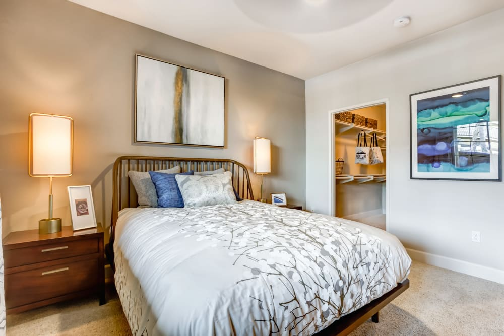 Well-decorated master bedroom with an accent wall in a model home at Sofi Highlands in San Diego, California