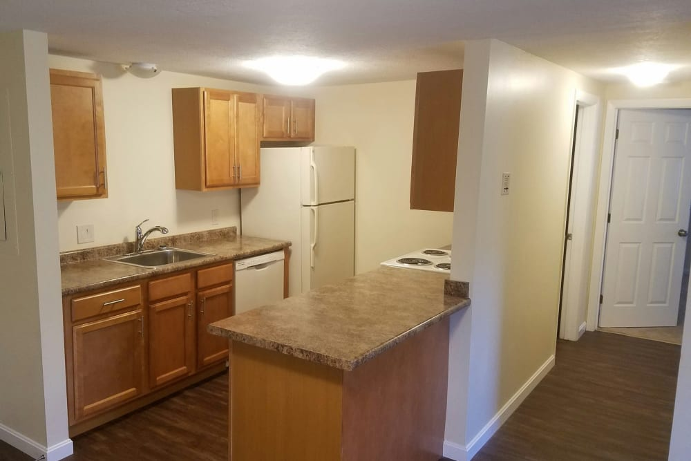 Kitchen with granite counters at London Court Apartments in Merrimack, New Hampshire