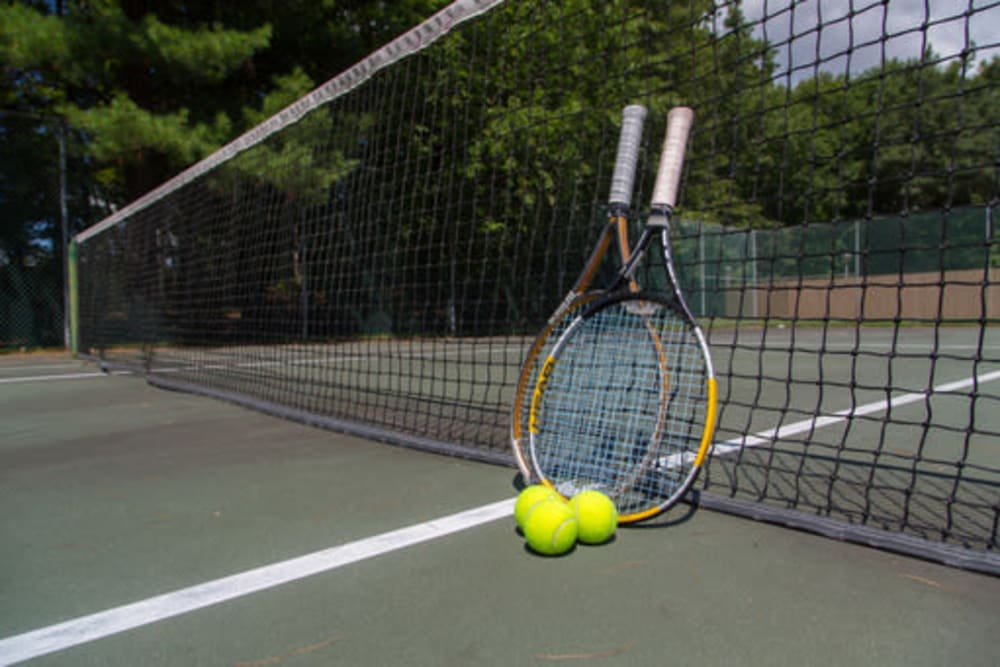 London Court Apartments offers a tennis court onsite in Merrimack, New Hampshire