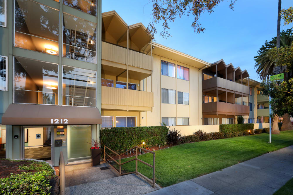 Exterior view at dusk of our classic, mid-century community at Sofi Redwood Park in Redwood City, California