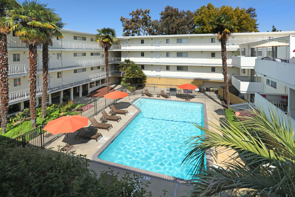 View of the swimming pool area from an upper floor at Sofi Redwood Park in Redwood City, California