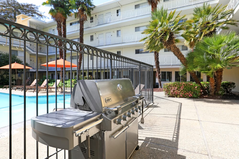 Barbecue area with gas grills near the pool at Sofi Redwood Park in Redwood City, California