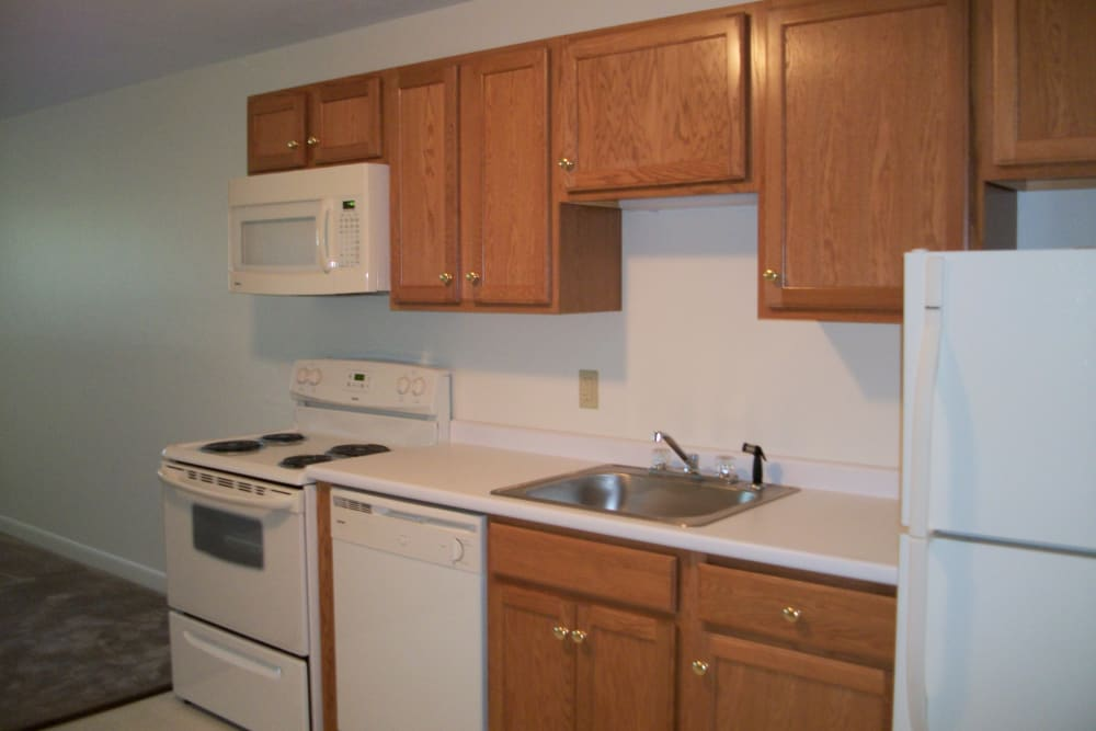 Fully equipped kitchen at The Woodlands Apartments in Londonderry, New Hampshire