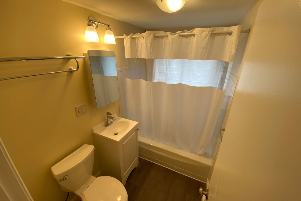Bright bathroom at The Woodlands Apartments in Londonderry, New Hampshire