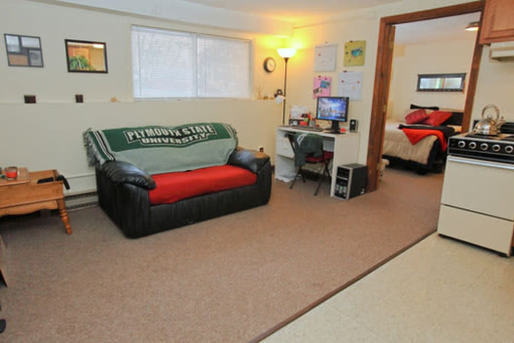 Spacious living room at Fox Park Apartments in Plymouth, New Hampshire