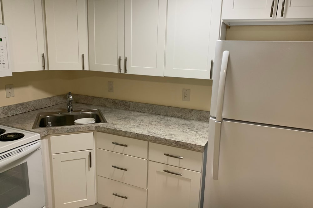 Bright, well equipped kitchen at Fox Park Apartments in Plymouth, New Hampshire