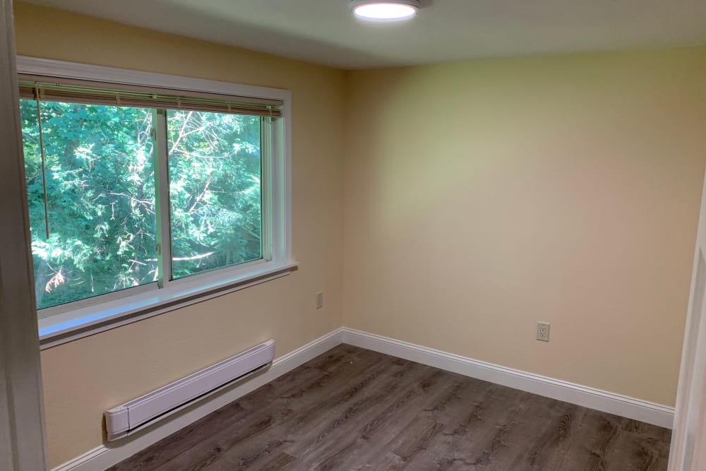 Bright bedroom at Fox Park Apartments in Plymouth, New Hampshire