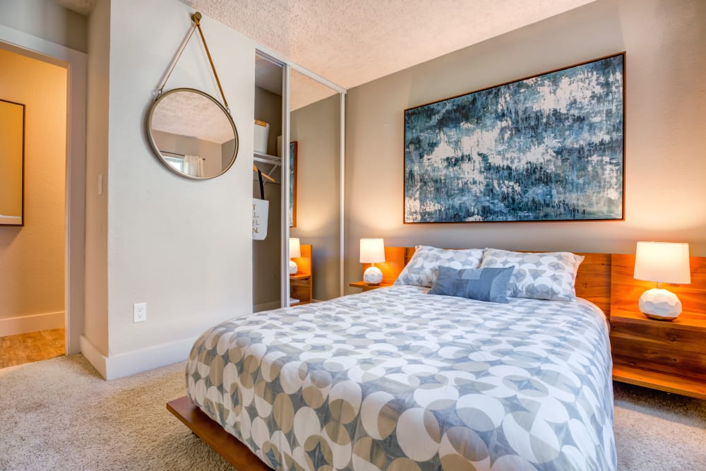 Well-furnished master bedroom with plush carpeting in a model home at Sofi Union City in Union City, California