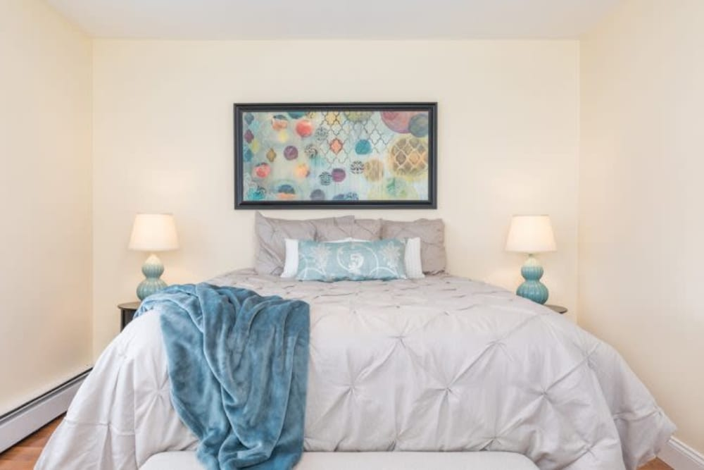 Well decorated bedroom at Olde Hampton Village Apartments in Hampton, New Hampshire