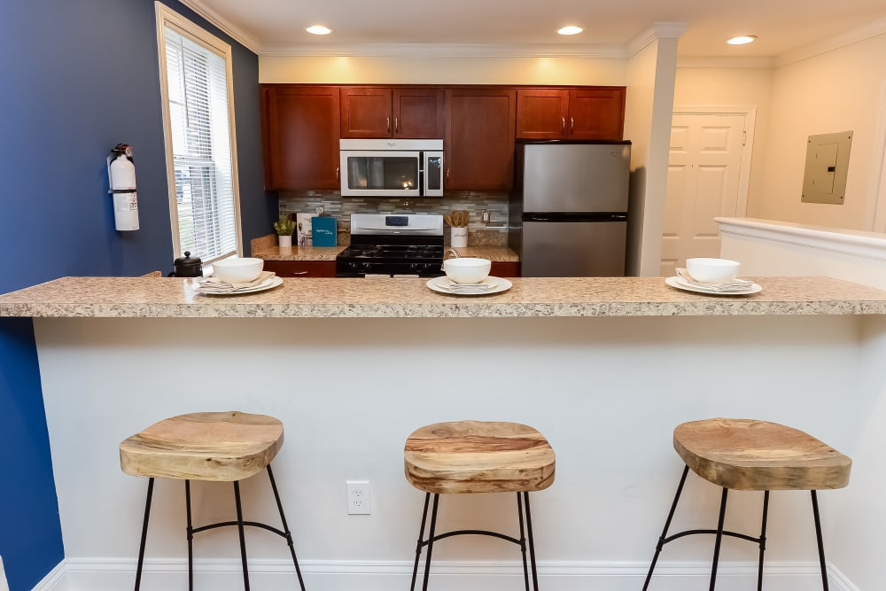 Kitchen with bar stool seating at The Villas at Bryn Mawr Apartment Homes