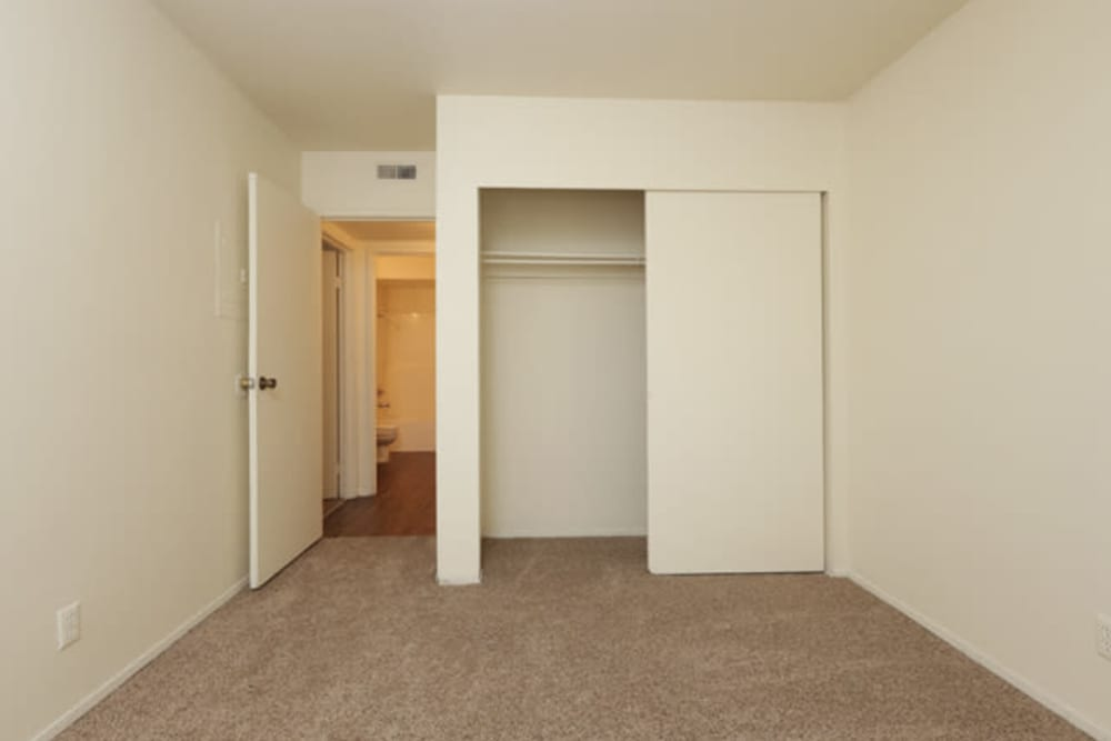 Spare bedroom with plush carpeting in a model home at Overlook Point Apartments in Salt Lake City, Utah