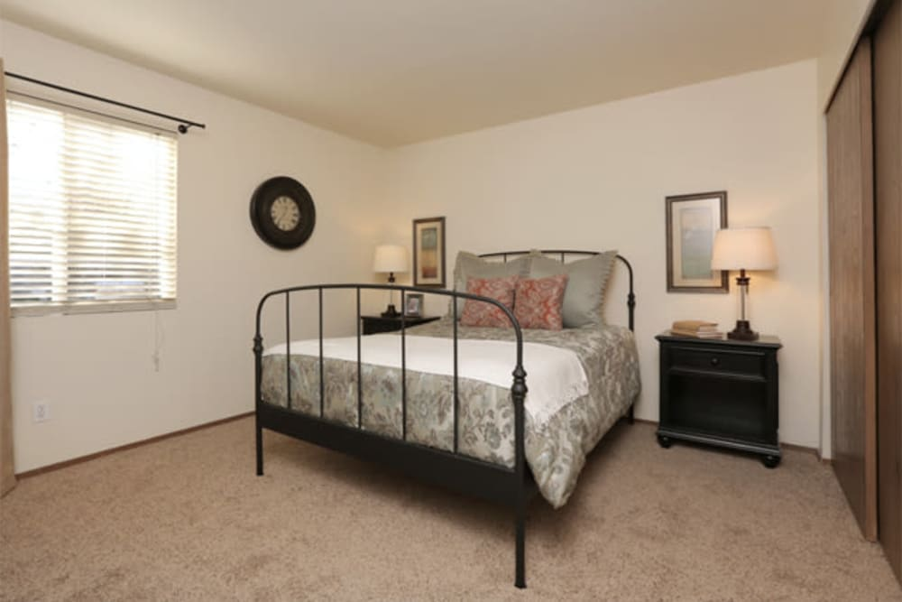 Minimalist decor in a model home's master bedroom at Overlook Point Apartments in Salt Lake City, Utah